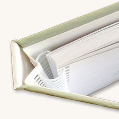 A concealed Wire O binding can used for either hardcover, hard case books, or soft cover books. The wire is concealed so it is not seen on the spine.