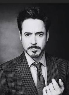 In the future, I want to meet someone like Tony Stark, not Robert Downey Jr., but Tony Stark. Tony Stark has the perfect beard and mustache and he's really cute. He's so confident, smart, and he has a suit.