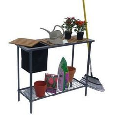 """Garden Utility/Potting Table by Jewett-Cameron Companies. $83.31. mfr: Jewett-Cameron Companies A great addition to your greenhouse and gardening activities. Easy, one-tool assembly gets you up and running in no time.• Place inside your greenhouse as extra storage• Convenient trimmings bin is removable• Composite wood top is eco-friendly and made from recycled materials• Dimensions: 15""""L x 39""""W x 32""""H"""