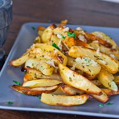 Roasted Potatoes With Garlic Sauce: Intrigued by the garlic, olive oil, and parsley topping that elevates the simple potatoes.