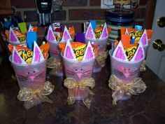 Cat Party Favors filled with Cheetos, Swedish fish and other cat related items.