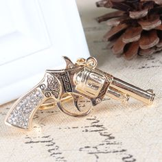 Pistol Gun Handgun Charm Pendant Crystal Purse Bag Key Ring Chain Exquisite GiftLoading that magazine is a pain! Get your Magazine speedloader today! http://www.amazon.com/shops/raeind