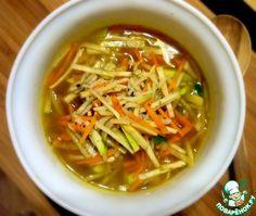 Густой рисовый суп по-китайски (Бульон(овощной), рис(басмати), морковь, сельдерей корневой, кольраби ,лук зеленый, петрушка, имбирь, перец черный, соевый соус, вино рисовое, перец чили
