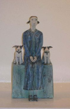 Anna Noel. Woman with two Dogs ceramic piece.