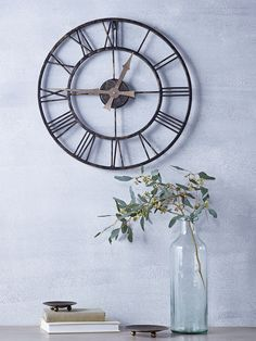 Suitable for both indoor and outdoor use, our oversized skeleton clock has a rustic aged metal iron frame with a vintage rust effect finish. Each weighty clock includes roman numerals set around elegant metal hands that have a smooth and silent tick. With two keyhole hooks on reverse for hanging, this large clock makes a standout accessory for your garden wall or indoor living space.