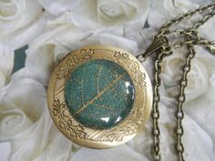 Bronze Keepsake Locket w/Gold Skeleton Leaf by giftforallseasons