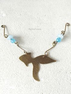 I made this little fish by hand, cutting and working the brass all by myself. Now I'm finishing the necklace with gemstones, brass links made by me and brass chain :) I'll bring this piece with me to the next craft market in Cigole (near Brescia, in Italy) next Sunday. #jewelry #sea #creatures #seaside #summer #boho #beach