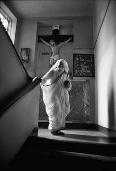 I think this photo speaks volumes, her frailness supported by the greatest strength of all....Mother Teresa coming down stairs, 1970. Photo © Raghu Rai/Magnum Photos