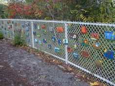neat idea... add lacquered wooden plaques to wired fence