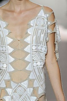 white sequins on nude silk
