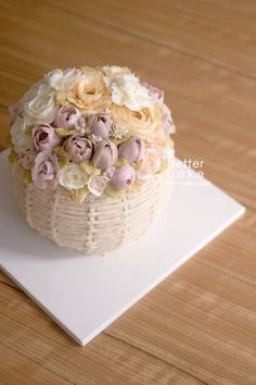 Butter Cream peony flowers on a basket base