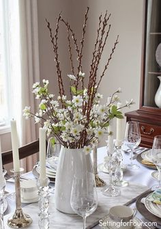 Spring tablescape idea: White flowering branches and pussy willows in a bright white vase.