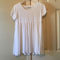 American Apparel baby doll dress Flowy, white baby doll/ t shirt dress. Size XS/S American Apparel Dresses Mini