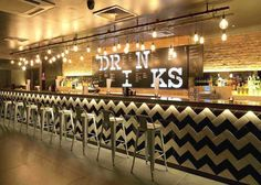 Chevron Backsplash | Subway Tile | Commercial Design | Bar Ideas | Stool Seating | Restaurant Interior