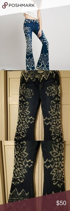 Free People floral flares jeans Only worn once,  small dirt stains on inside as the are to long and draged on the ground please see photos,  size 31, price is firm on jeans,  smoke free home Free People Jeans Flare & Wide Leg