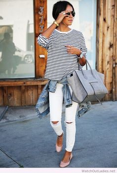 Grunge but polished with a striped tee and a jacket tied around her waist