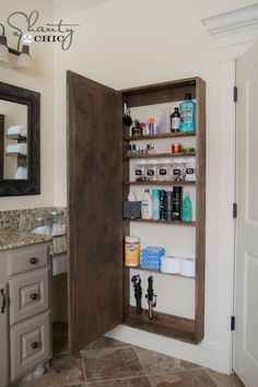 Hide narrow storage shelves behind a full-length bathroom mirror to make the most of the available space.