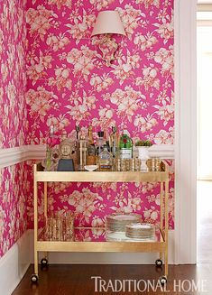 Floral pink wallpaper... and that  bar  car  is  screaming for someone to make me a pretty pink drink!