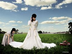 Surreal fashion photography outdoor shot, by Manuel Araya. Beautiful outdoor blue skies and clouds.Gorgeous women in great dresses. Love it!