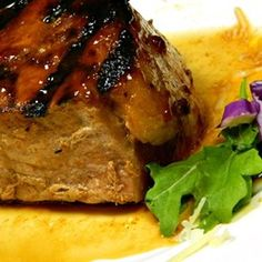 Honey Garlic Pork Chops -  1/2 cup ketchup 2 2/3 tablespoons honey 2 tablespoons soy sauce  2 cloves garlic, crushed  6 (1-inch thick) pork chops Whisk ingredients together and brush chops as grilled