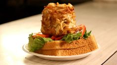 The Crab Cake Sandwich at Faidley Seafood in Baltimore. These traditional sammies are filled with 6.5 ounces of jumbo lump crabmeat, fried to perfection.
