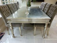 Metallic Furniture  Sassy Silver Dining TableEntertain your friends around this beautifully carved French  . Dining Table Painted Gold. Home Design Ideas