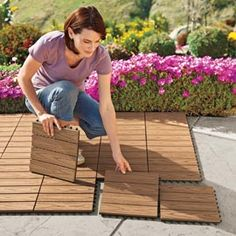 I need to do this to my backyard deck. Vifah Deck Squares Turn boring cement into a beautiful wood-look deck that won't rot, splinter or split. Can get at ikea. Outdoor Spaces, Outdoor Living, Outdoor Decor, Outdoor Projects, Home Projects, Diy Garden, Home And Garden, Garden Path, Rooftop Garden