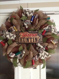 Gone hunting wreath with camo and burlap ribbon and mesh. Designed and created by Ronda Cromeens. Large 50$ (extra cost for burlap and decor)