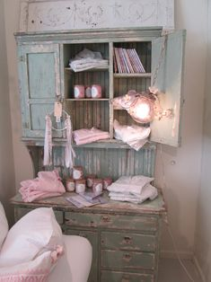 Vintage cabinet displaying wallpaper candles, notebooks, pj's and the darling Twig Light