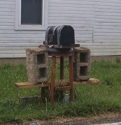 The combination duct tape, cement block, stool and wood fix..  Genuis!