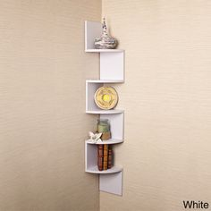 Show off your favorite items in style with this set of two S-shaped wall mount shelves. Available in either a white or espresso finish, the sleek lines of these shelves create an ultra-modern display