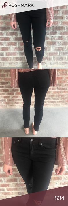 """Astrid Black Ripped Knee Jeans- New! These black jeans feature ripped knees and a fringed hem detail. They're full length and mid rise. Super comfortable and can be paired with so many different tops!  Model is 5'5"""" wearing a size 3. Jeans run true to size.  New product Pants Skinny"""