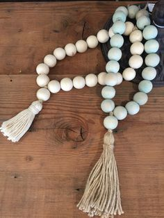 Boho Wood Decor Beads with cotton tassel, available at Vintage Home OC Wood Bead Garland, Diy Garland, Beaded Garland, Wooden Bead Necklaces, Wooden Beads, Diy Tassel, Tassels, Home And Garden Store, Deco Nature