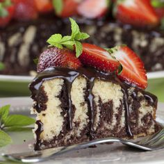 A Fancy looking but simple to make marble cake recipe, served topped with ganache and strawberries.. Marble Cake With Ganache Recipe from Grandmothers Kitchen.
