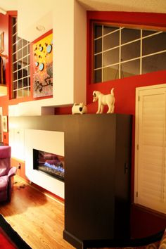 Contemporary art inspired living room design and fireplace remodel by TVL Creative