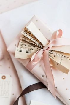 pretty gift wrapped with ribbon & music sheets