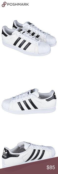 Adidas Men's 11.5 Superstar Sneakers White Black NEW! Adidas Men's size 11.5 Superstar Sneakers. White/Black with custom texture. Adidas branding on heel and tongue. Three adidas stripes on paneling. Sold without box. These rare sneakers are a trendy staple! adidas Shoes Sneakers