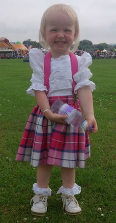 "Just too cute for words! 2yr old Eilidh in her #Bonnie #Blush #Tartan National Skirt. Photo from her mum Elizabeth Budge in Halkirk, Scotland with comment: ""She's a wee monkey and loves wearing her skirt, her sisters danced at the pipe band tonight and she had to get it on."""