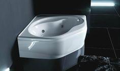 Stylish bathroom with large corner bathtub by Treesse / Aurora Collection