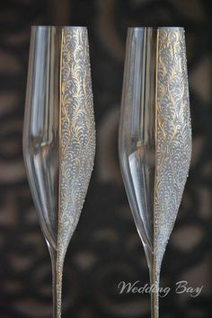 Item details: Pair of champagne flutes hand decorated with an original design. Dimensions: Toasting flute: h=275mm d=50mm Capacity: 190ml. Personalization: Names and date may be hand engraved, painted or embossed to customize the flutes and the shots to your occasion. Please be aware