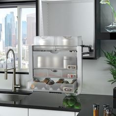 Have to have it. Rev-A-Shelf Chrome Universal Pull Down Shelf - $699.99 @hayneedle