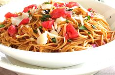 Spaghetti Pomodoro is delicious in its simplicity with its ingredients of spaghetti, tomatoes, garlic, olive oil, basil and parmesan.