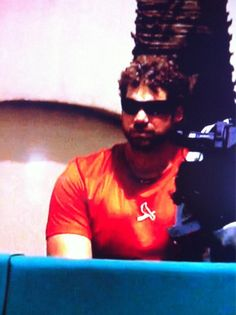 Carp with his DL curly hair watching the game 3/23