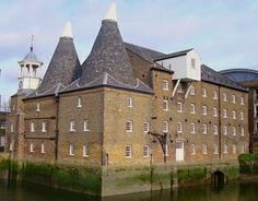 One of the 'Three Mills' in Bow, The Clock Mill. When fully operating, Three Mills was the largest tidal mill complex in England. The buildings that exist today were built in the 18th and 19th centuries.