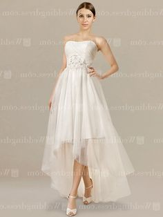 High-low beach wedding dress is a truly elegant and lovely silhouette on your special day. The strapless bodice is embellished with stunning lace appliques and beading. You will also love the high-low skirt that will make you stand out.