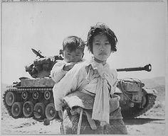 Korean War Pictures: Korean War Pictures - Korean Girl and Brother by a M-26 Tank