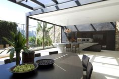 A splendid loft occupying 180 square meters of modern interior space strongly connected to nature and decks connecting the different zones in Sao Paolo, Brasil.