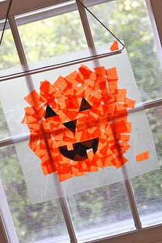 tissue paper pumpkins on contact paper