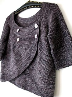 """Looks like this is """"Shift of Focus"""" by Veera Välimäki available on Ravelry- http://www.ravelry.com/patterns/library/shift-of-focus"""