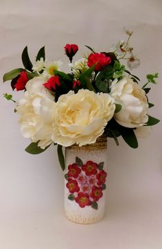 Up-Cycled tin can vase, texture comes from papier mache and paper clay floral design. Shown here with silk flowers.